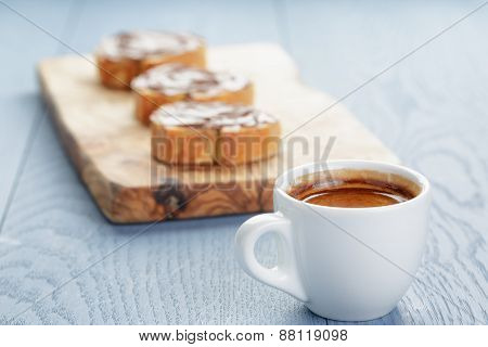 simple breakfast with cup of espresso and baguette slices with chocolate spread