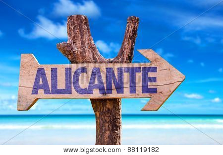 Alicante wooden sign with beach background