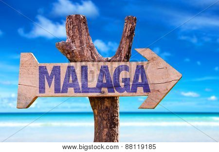 Malaga wooden sign with beach background