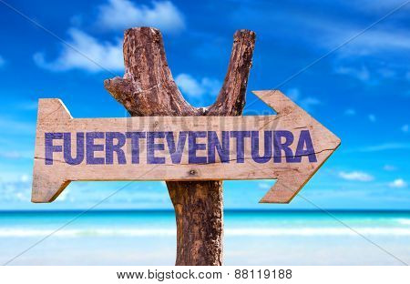 Fuerteventura wooden sign with beach background