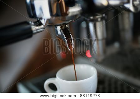 preparing espresso on professional coffee machine