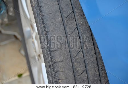 Worn Tire Of A Blue Car Detail Photo