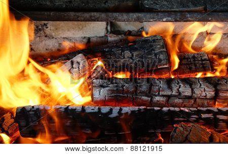 charred wood in flames