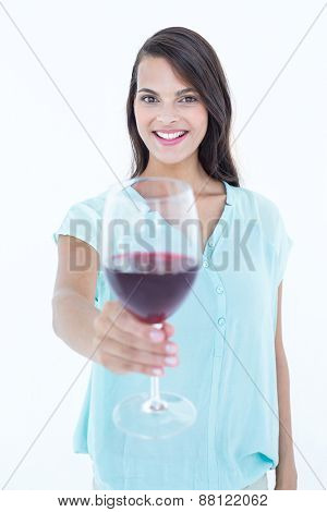 Pretty woman with red wine glass on white background