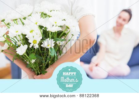 mothers day greeting against daughter giving mother white bouquet
