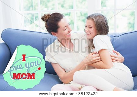 mothers day greeting against mother and daughter laughing on couch