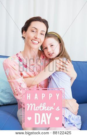 mothers day greeting against little girl with her mother on sofa