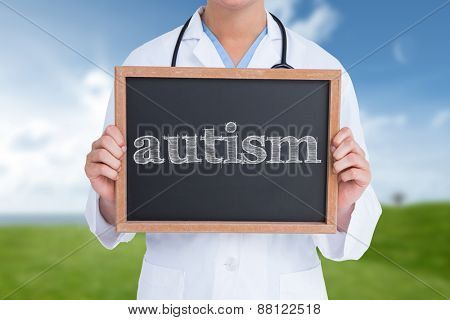 The word autism and doctor showing little blackboard against field and sky