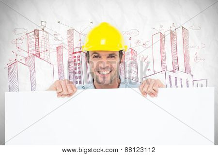 Architect with bill board over white background against crumpled white page