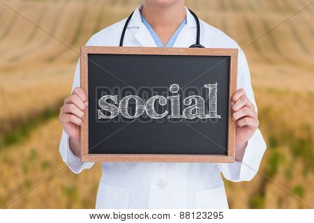 The word social and doctor showing little blackboard against rural fields