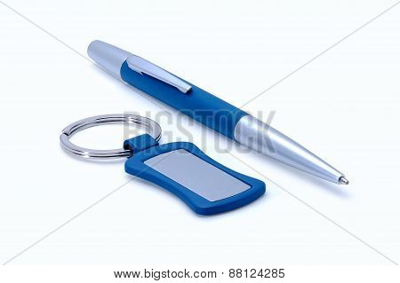 Silver-blue Metal Pen And Keychain Isolated On White