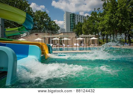 person riding down a water slide
