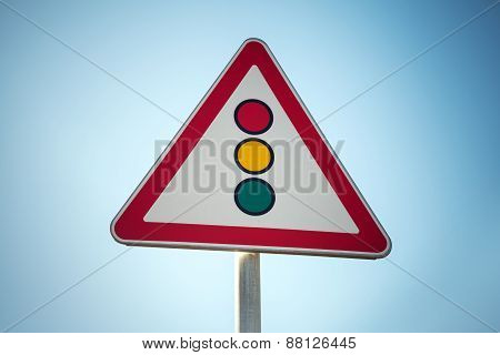 Traffic Lights. Triangle Road Sign Over Blue Sky Background