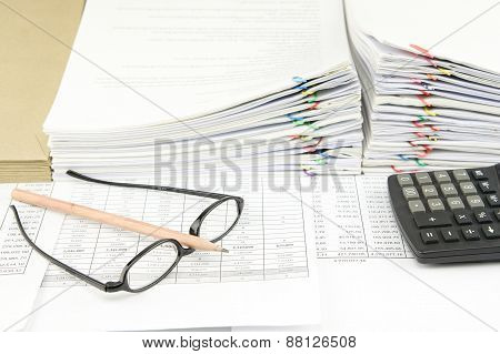 Brown Pencil On Spectacles And Calculator
