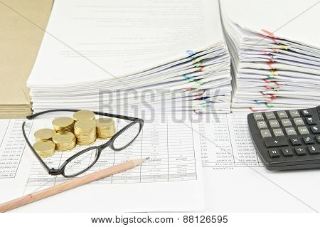 Brown Pencil With Spectacles And Gold Coins