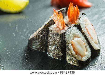 Rolls with shrimp on the black