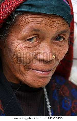 KATHMANDU, NEPAL-DECEMBER, 2009 - An unidentified nepalese woman doing their daily life duty along t
