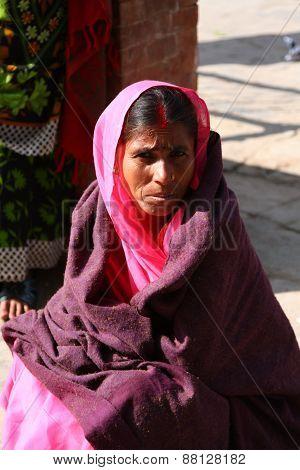 KATHMANDU, NEPAL-DECEMBER, 2009 - An unidentified nepalese woman doing their daily life duty along t