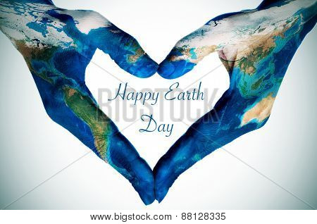the hands of a young woman forming a heart patterned with a world map (furnished by NASA) and the text happy earth day