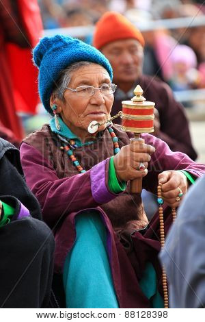 LEH, INDIA-MAY, 2012 - An unidentified tibetan old woman praying in a meeting session with his holin