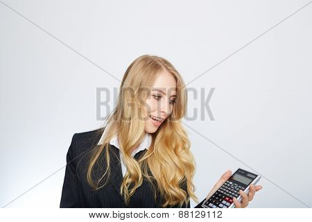 attractive smiling business woman with calculator