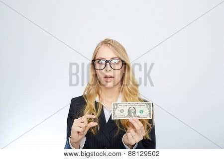 Attractive business woman.  Holding a one dollar and euro.