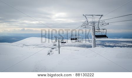 Ski lift cable way in the mountains