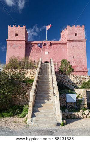 Flag flying above Saint Agatha's Tower also known as The Red tower. It was one of the defensive battlements of Malta.