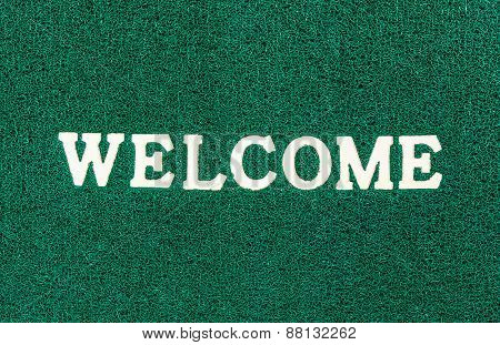 Green Doormat And Welcome Text