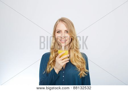 Young woman with orange juice, isolated on white