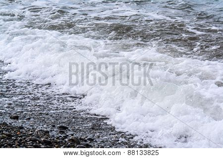Sea waves on a pebbly shore