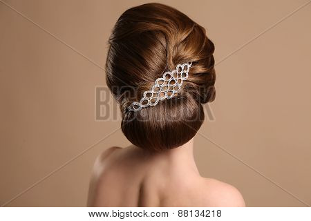 Woman With Elegant Retro Hairstyle With Hair Accessory