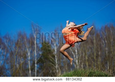 Young Gymnast Doing Exercises