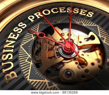 Business Processes on Black-Golden Watch Face.