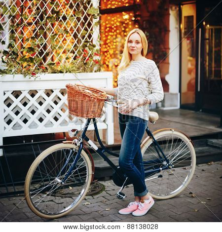 Young Stylish Woman On A Vintage Bicycle