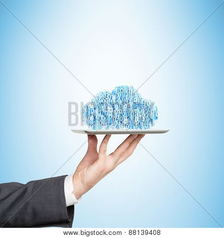 A Hand Is Holding A Tablet With The Social Media Icons As A Cloud