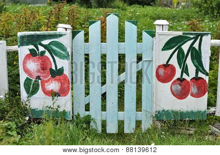Wooden Gate With A Picture
