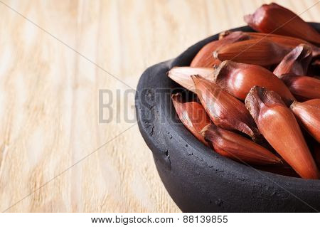 Pinhao - Brazilian Pine On Wooden Table In Black Pot With Copy Space