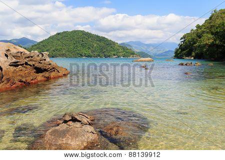 Transparent Sea And Stones Near Beach Cotia On Island Near Paraty, Brazil