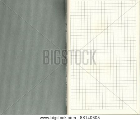 Notepad with checkered paper and grey cover