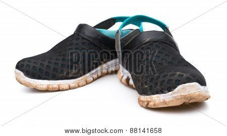 Pair Of Dirty Shoes On White Background