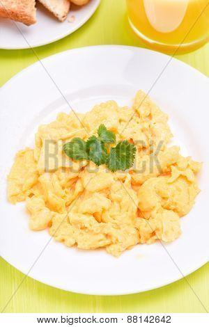 Scrambled Eggs On White Plate