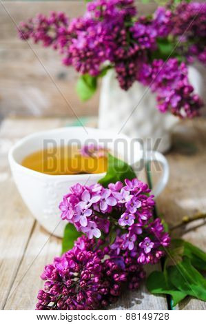 Lilac Flowers In A Rustic Interior