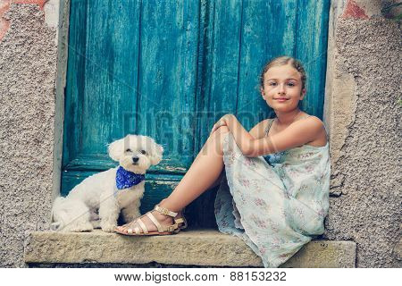Portrait of fashion girl with Maltese dog, Italy