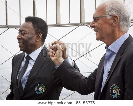 NEW YORK - APRIL 17, 2015: Soccer legends Pele and Franz Beckenbauer from the New York Cosmos on the observation deck of the Empire State Building to launch and celebrate the start of the 2015 season.