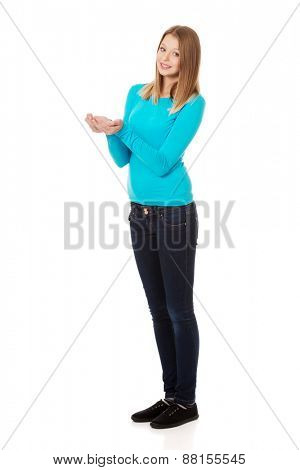 Teenage woman with cupped hands