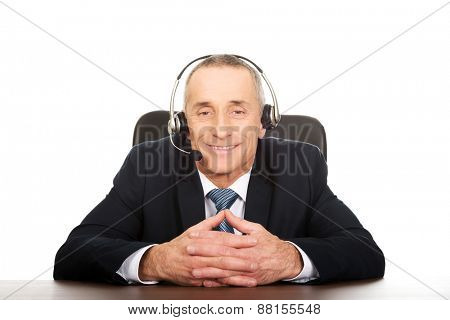 Mature call center man sitting in the office.
