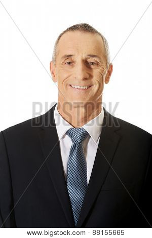 Mature businessman smiling to camera.