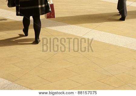 Woman legs on a walkway