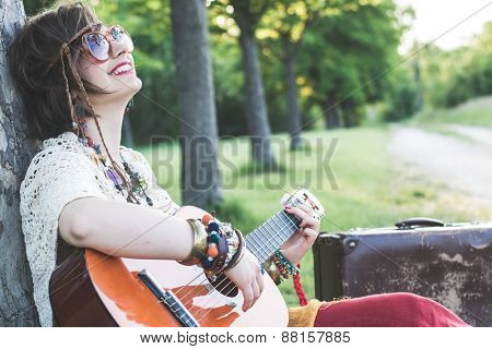 Hippie woman playing guitar